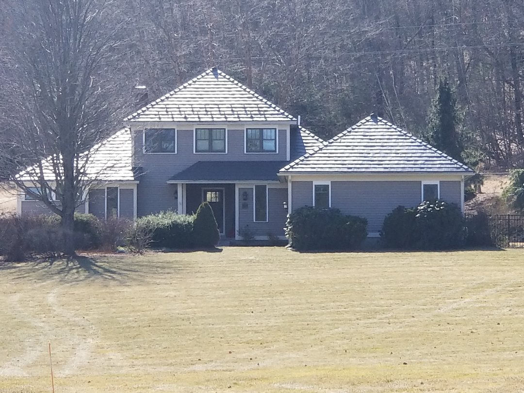 Berlin, MA - Aluminum shingle, Oxford in deep charcoal. A true lifetime metal roofing product.