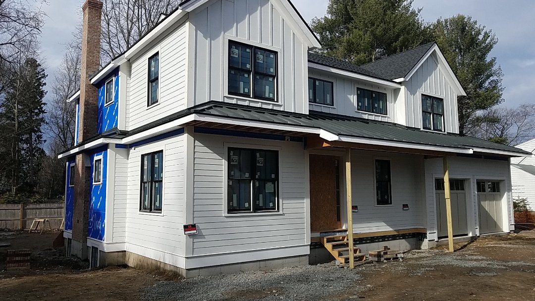 Wellesley, MA - Accent roofs can make a house. This beautiful charcoal gray wrap around porch looks fantastic!
