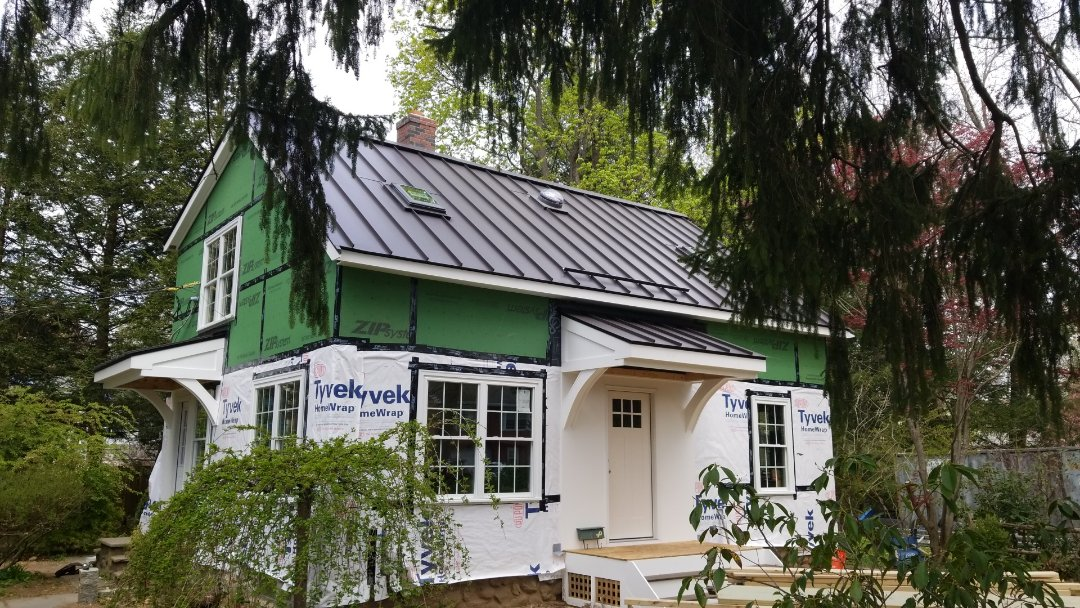 Maynard, MA - New standing seam metal roof on new construction.dark bronze aluminum roof.