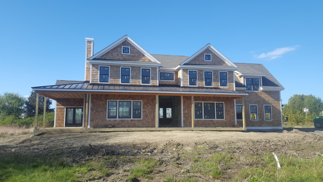 Portsmouth, RI - Porch roof on new construction aluminum metal standing seam roof