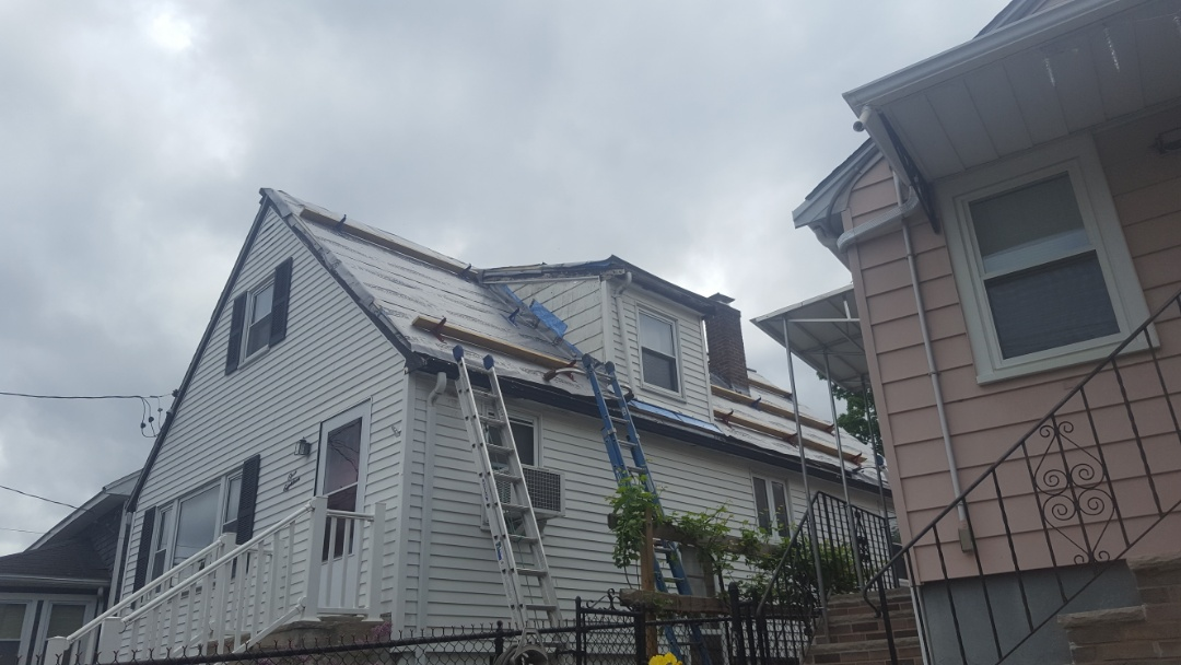 Waltham, MA - Stripping under way coming soon aluminum metal standing seam roof