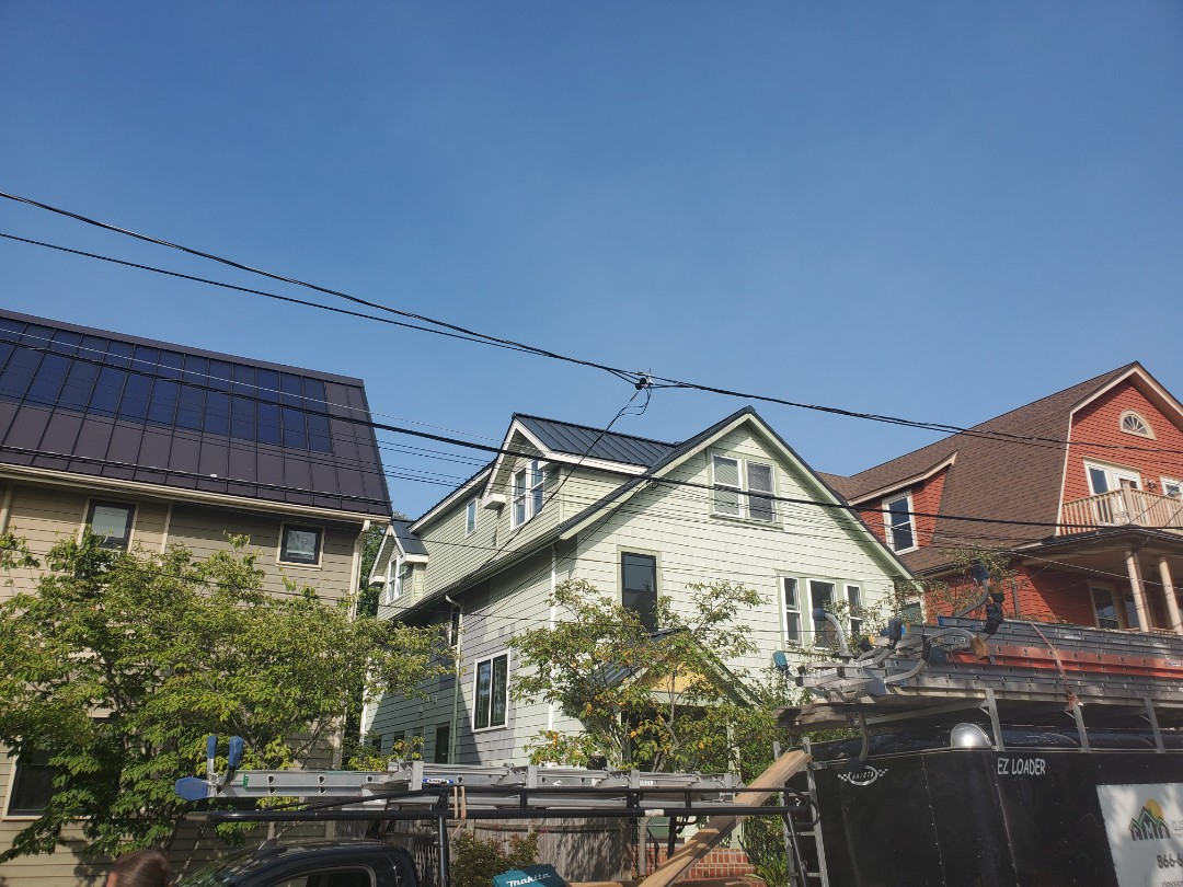 Cambridge, MA - Aluminum metal standing seam roof with aluminum shingles