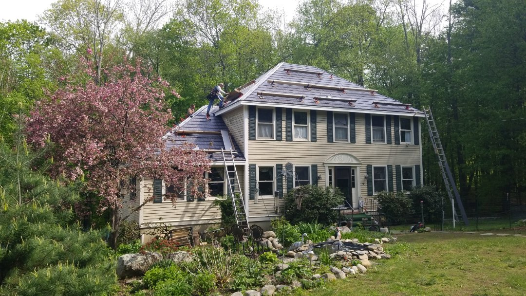 Pepperell, MA - I'm here in Pepperell. The metal roof in Oxford slate aluminum shingle looks great.