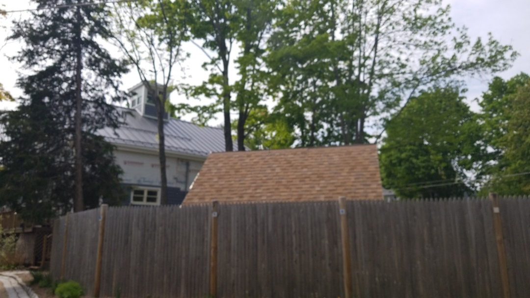 Acton, MA - Retrofit S-5 snow retention installed in Acton, MA on a standing seam metal roof.