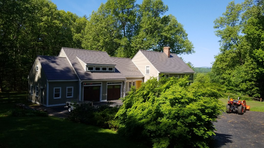Bolton, MA - Beautiful setting for a beautiful Oxford slate roof. The color is shake gray on this expanded cape.