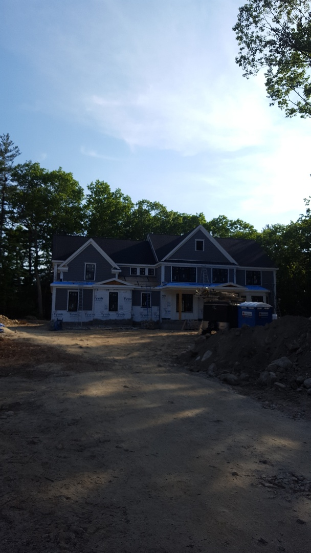 Hopkinton, MA - Multiple accented metal roofs in Hopkinton MA. Matte Black standing seam on new construction.
