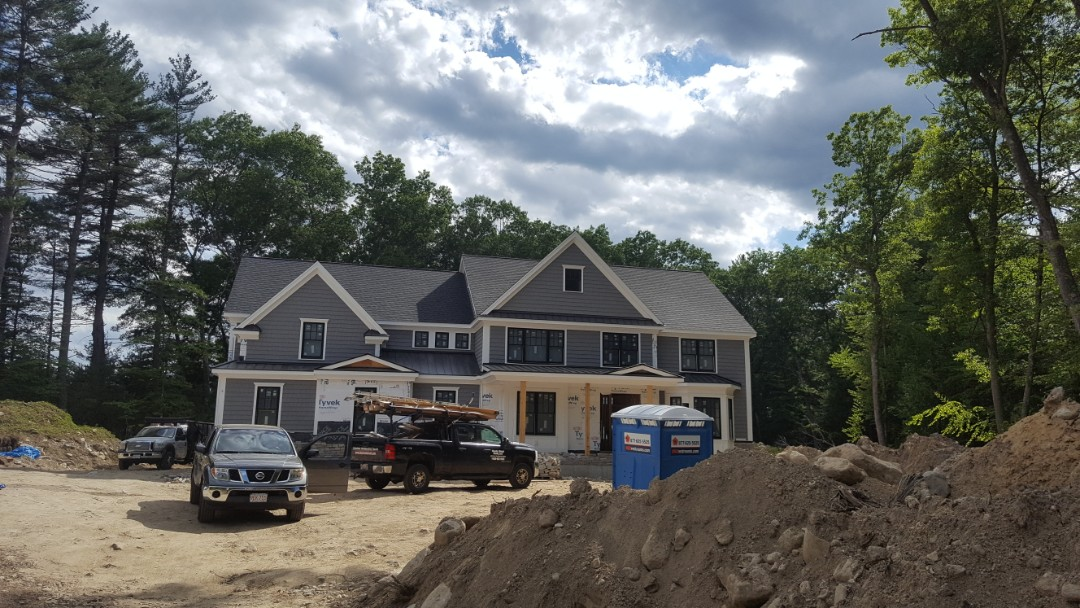 Hopkinton, MA - Complete 5 accent roofs on new construction in Hopkinton MA. MATTE BLACK standing seam.