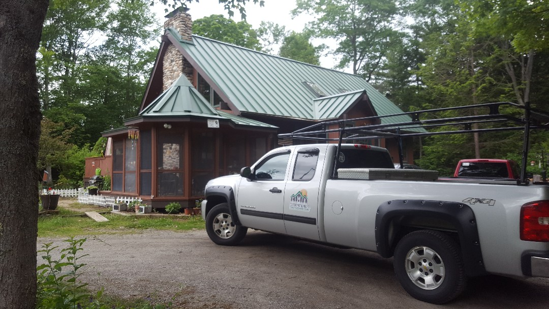 Hubbardston, MA - Standing seam roof in the color forest green. This beautiful home is located in central Massachusetts. Our aluminum roofing will last a lifetime!