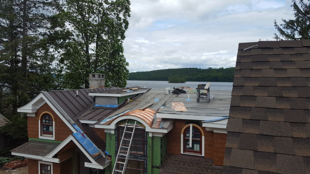 New Fairfield, CT - Lake house in New Fairfield Conn. With copper barrel roofs and aluminum double lock standing seam metal roof