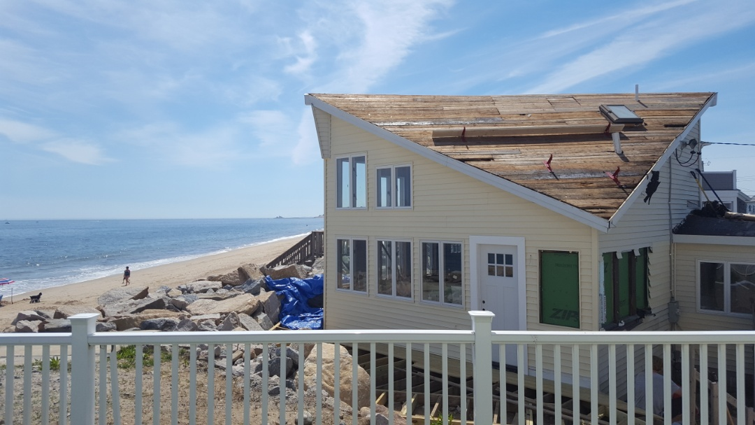 Westerly, RI - This cottage on the beach in Westerly Rhode  Island will be ready for hurricane season with a new aluminum double lock standing seam roof
