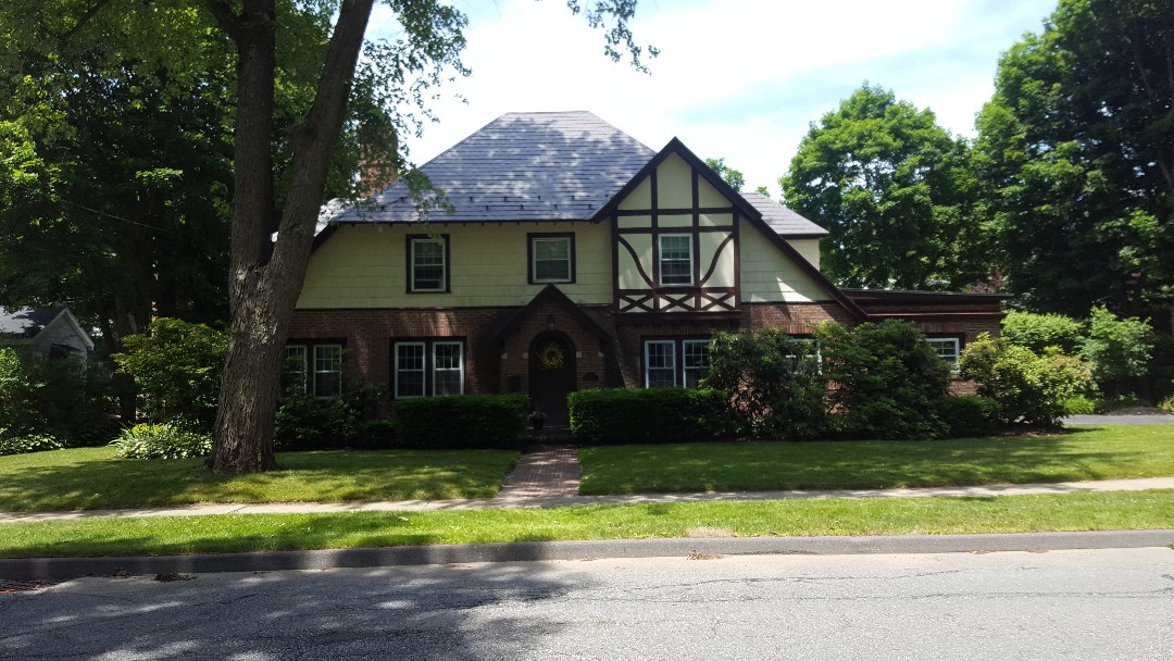 Gardner, MA - This beautiful tudor style in Gardner MA sporting a new press formed aluminum shingle representing its former slate roof which was replaced.