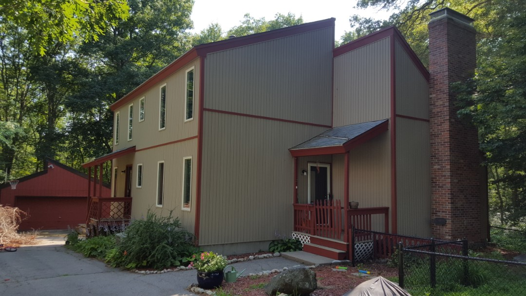 Sharon, MA - Contemporary looking to upgrade it's roof to an aluminum standing seam to mitigate ice dams above the vaulted ceilings.