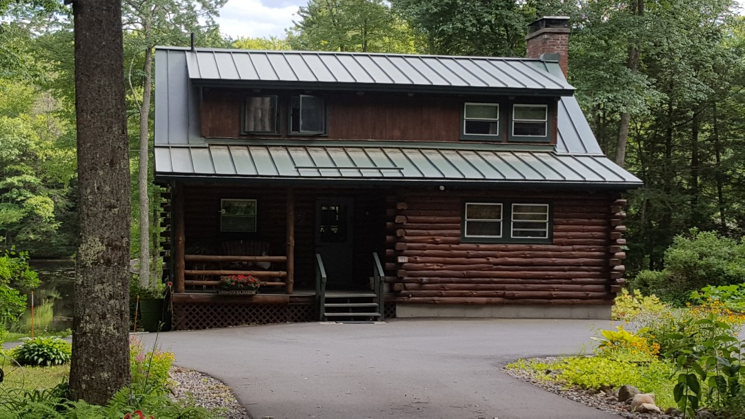 Phillipston, MA - A Classic Metal Roof standing seam in the color Forest Green on a beatiful log cabin