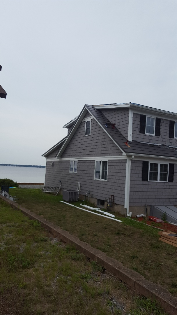 Warwick, RI - Oxford Slate metal shingle and standing seam.Both in aluminum. A great choice for this waterfront property in Rhode Island.