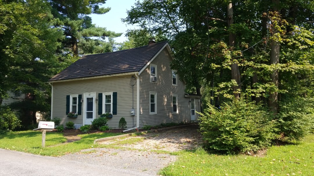 Framingham, MA - Rustic shake roof , aluminum metal shingle. Lifetime warranty. This one was done about 10 years ago. Framingham, MA.