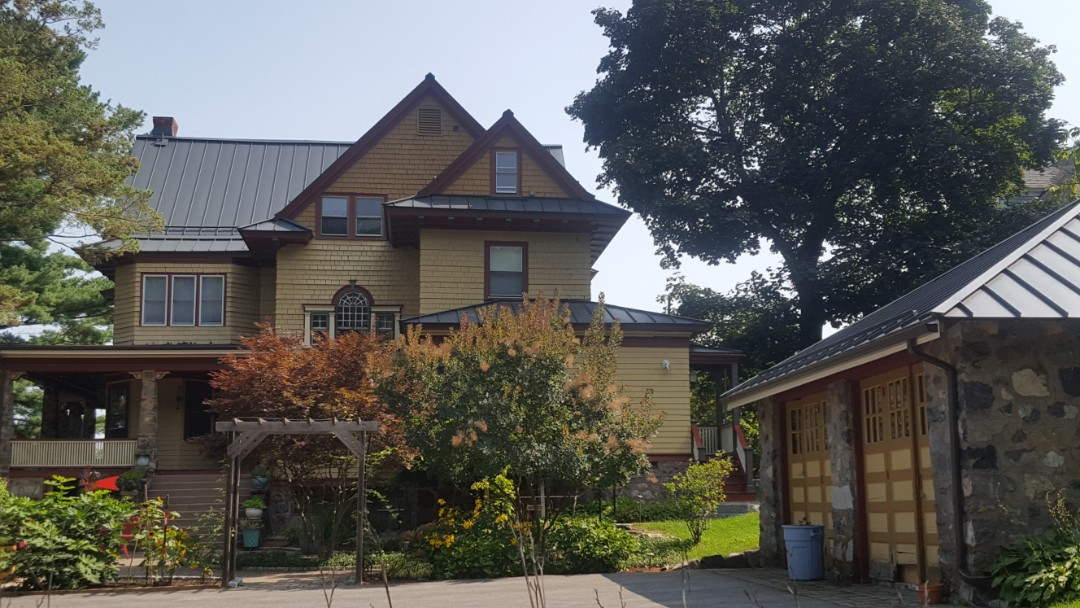 Melrose, MA - Victorian dresses up in a standing seam aluminum roof outside of Boston MA