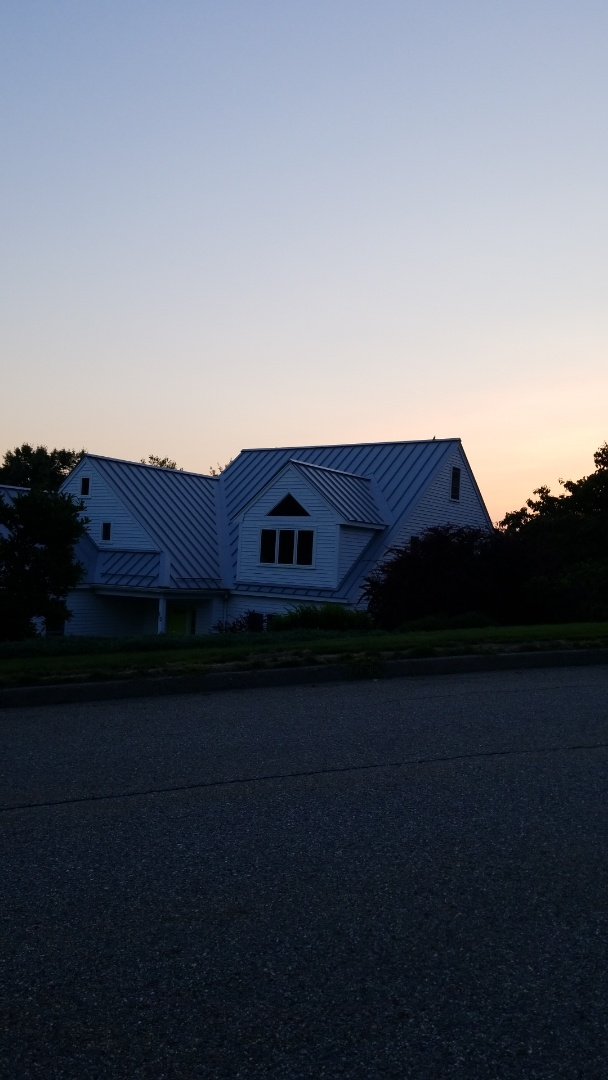Hudson, MA - Beautiful sunset over an aluminum standing seam metal roof.