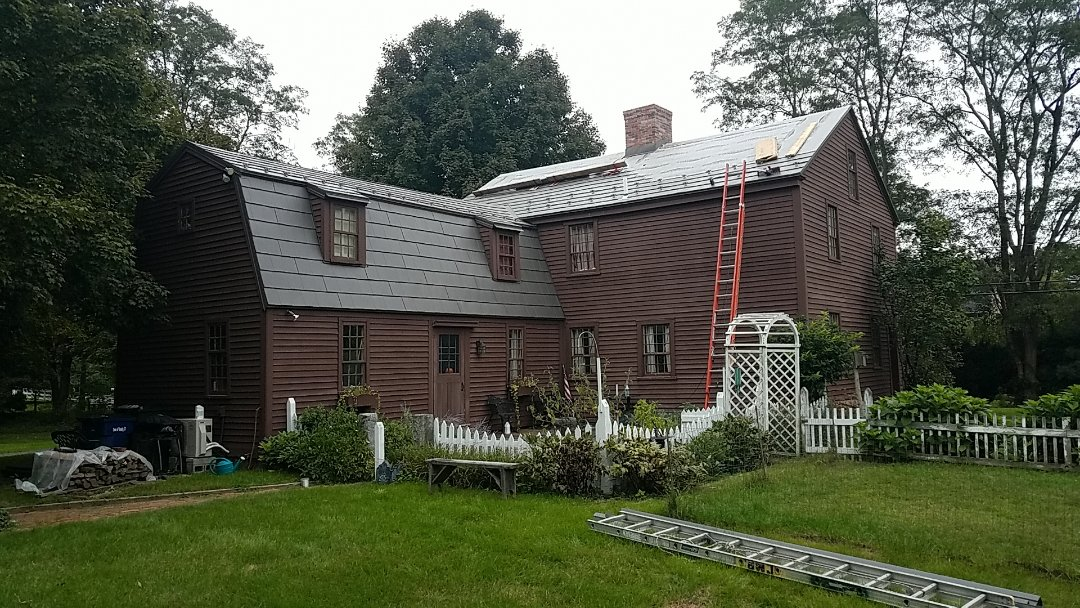 Granby, CT - Antique home getting a new Oxford slate aluminum metal shingle roof in the color shake gray.