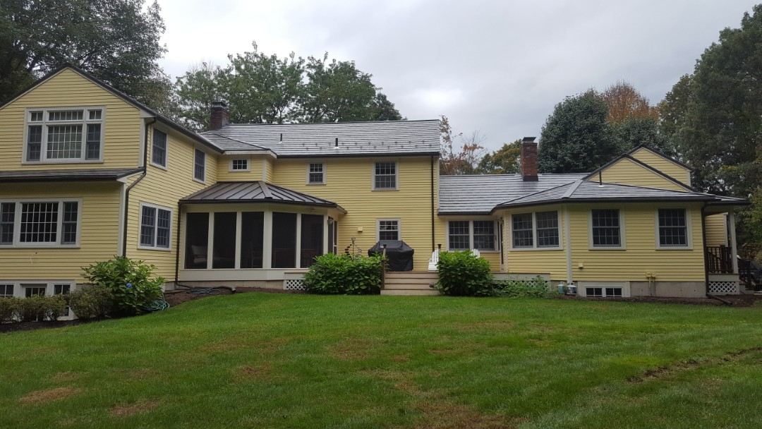 Sudbury, MA - Oxford aluminum metal shingle with standing seam roof on screened porch roof . We replaced an asphalt shingle roof