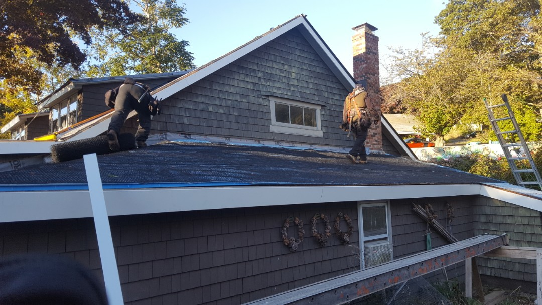Lincoln, RI - This job is under way in Lincoln Rhode Island .We striped off asphalt shingles and installing new ventallation system under aluminum standing seam metal roof
