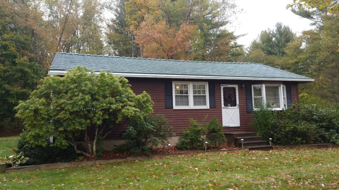 Spencer, MA - Rustic shake aluminum shingle metal roofing. Forest green. When it comes to metal roofs we have it all for every homeowner.