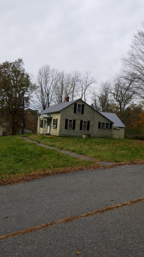 Hubbardston, MA - Ha! A metal roof that belongs on a barn.