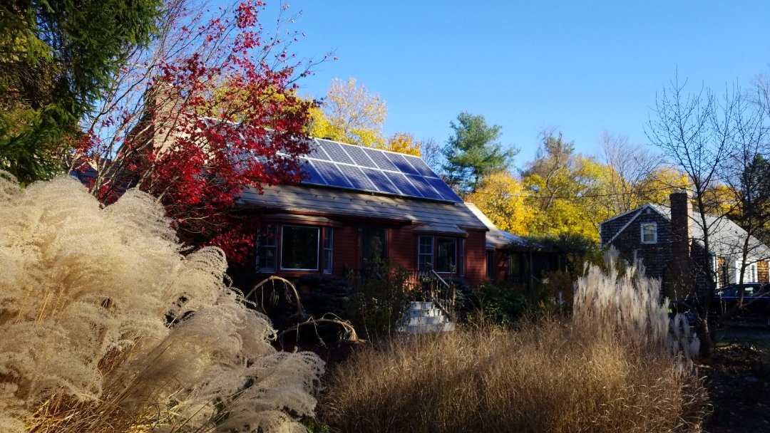 Acton, MA - Cape style home with the Oxford aluminum metal shingle roof. Fully compatable with solar. Great look very green and sustainable.