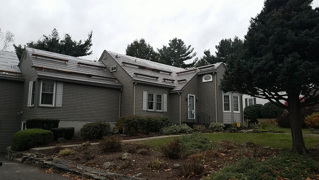 Worcester, MA - The Oxford slate aluminum shingle metal roof is being installed on this nicely maintained city home. We should have it done next week. If it stops raining that is.