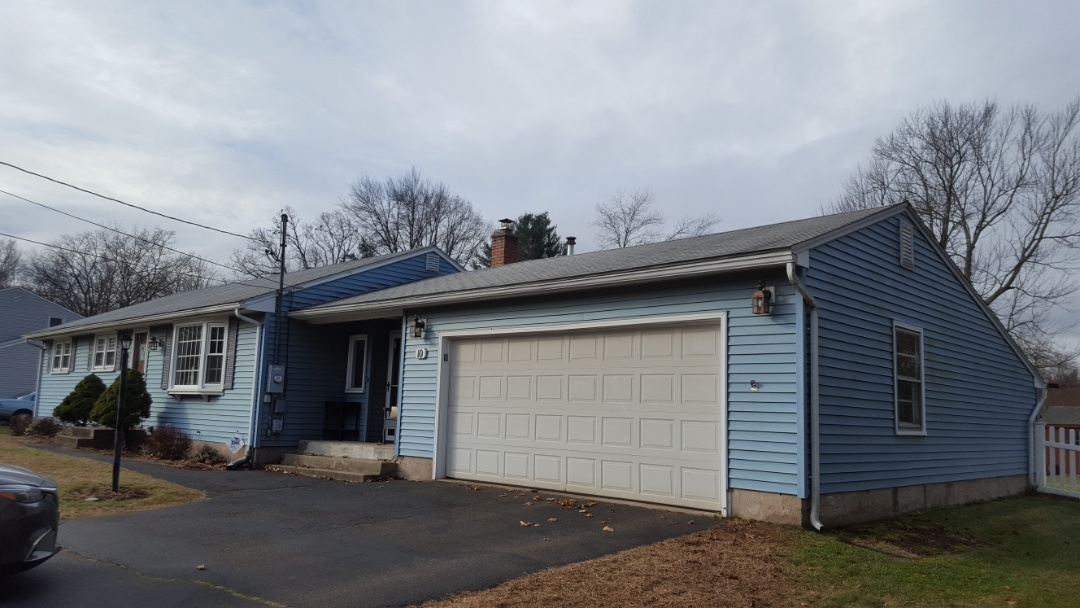Enfield, CT - Ranch looking for a lifetime press formed aluminum shingled roof.