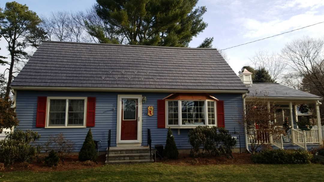 Hudson, MA - The oxford metal shingle in slate ro gray. Just completed. Bay windows in custom copper panels. Low slope dormer in IB  PVC membrane roofing. All warranties are for life!