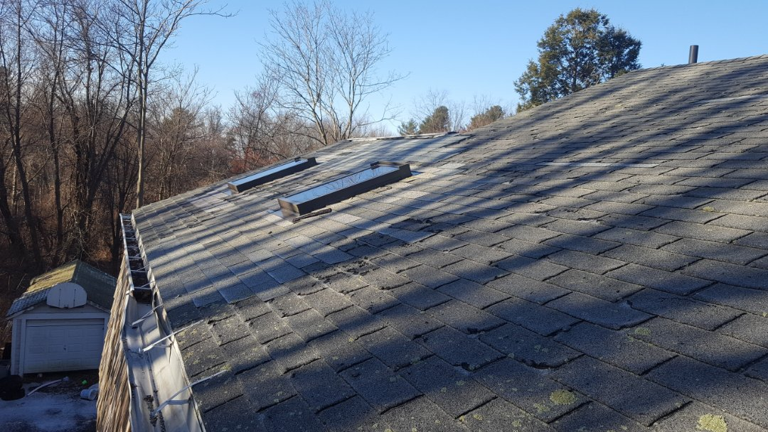Marlborough, MA - Checking skylights before installing new aluminum metal roif is installed