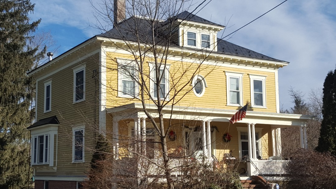 Templeton, MA - Black press formed metal shingle on this bright colonial hip roof.