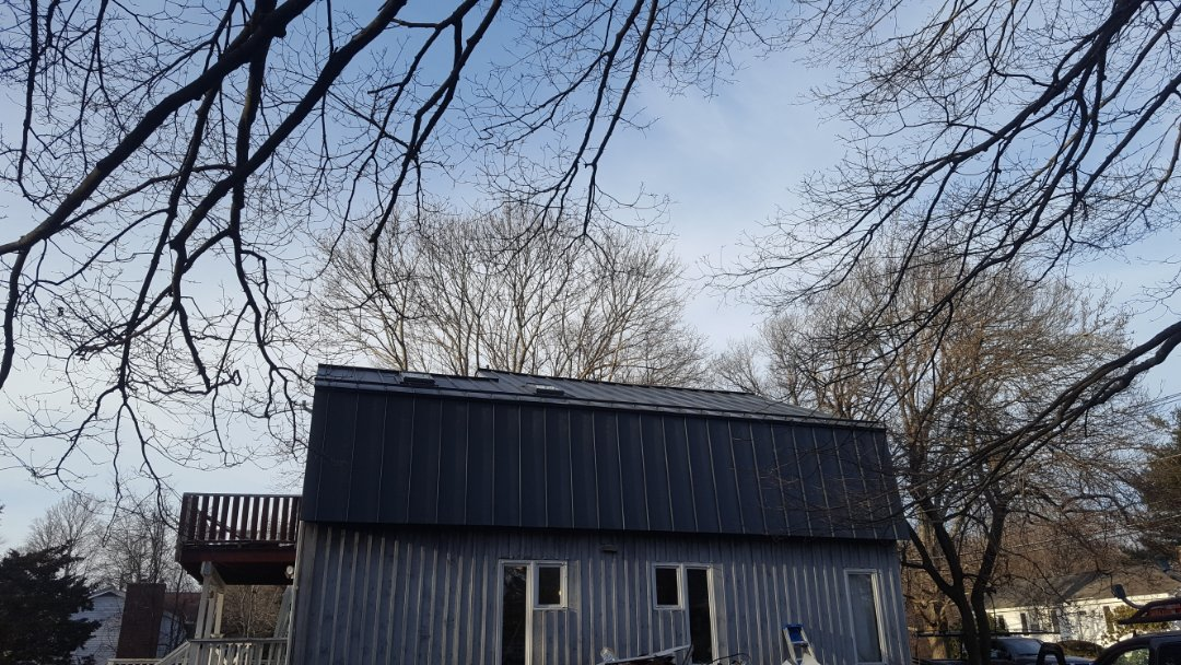 Marlborough, MA - Aluminum metal standing seam roof with matching color aluminum soffit