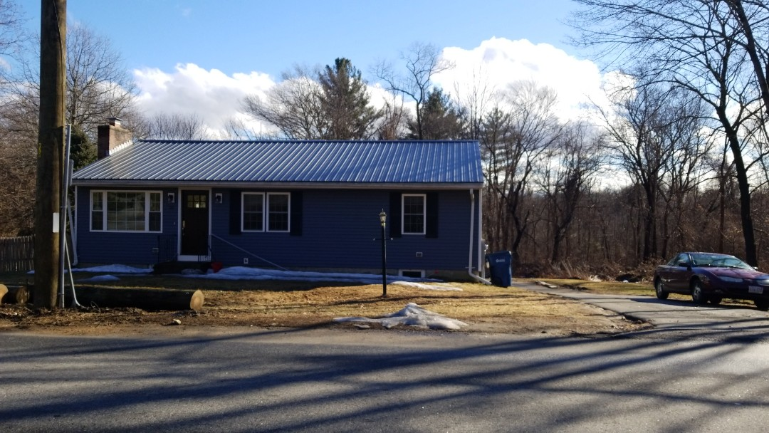 Acton, MA - Agricultural metal roof installed on a house. Problems waiting to happen .Steel roof that is face fastened.