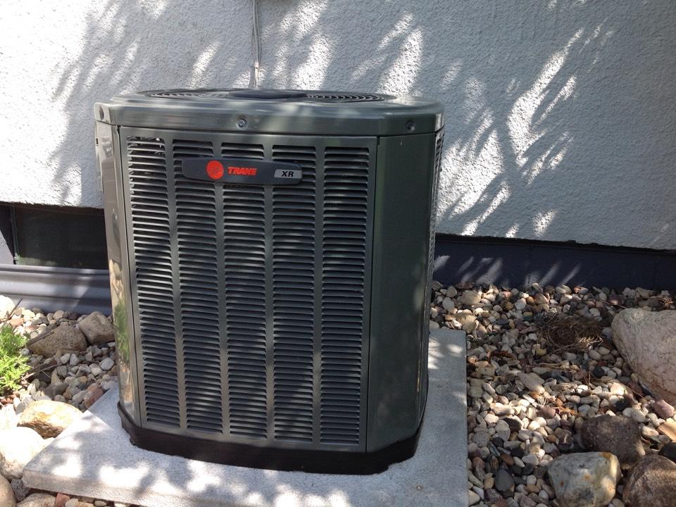 North Mankato, MN - Ac top off, peak performance testing on air conditioner, new installation of TRANE equipment