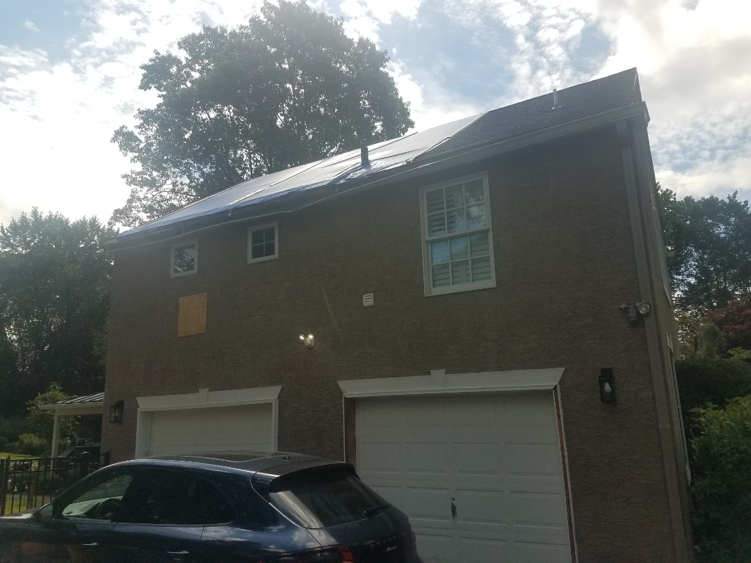 Penn Valley, PA - Tree fell on house.  Replacing plywood, fascia board and capping, soffit, and stucco