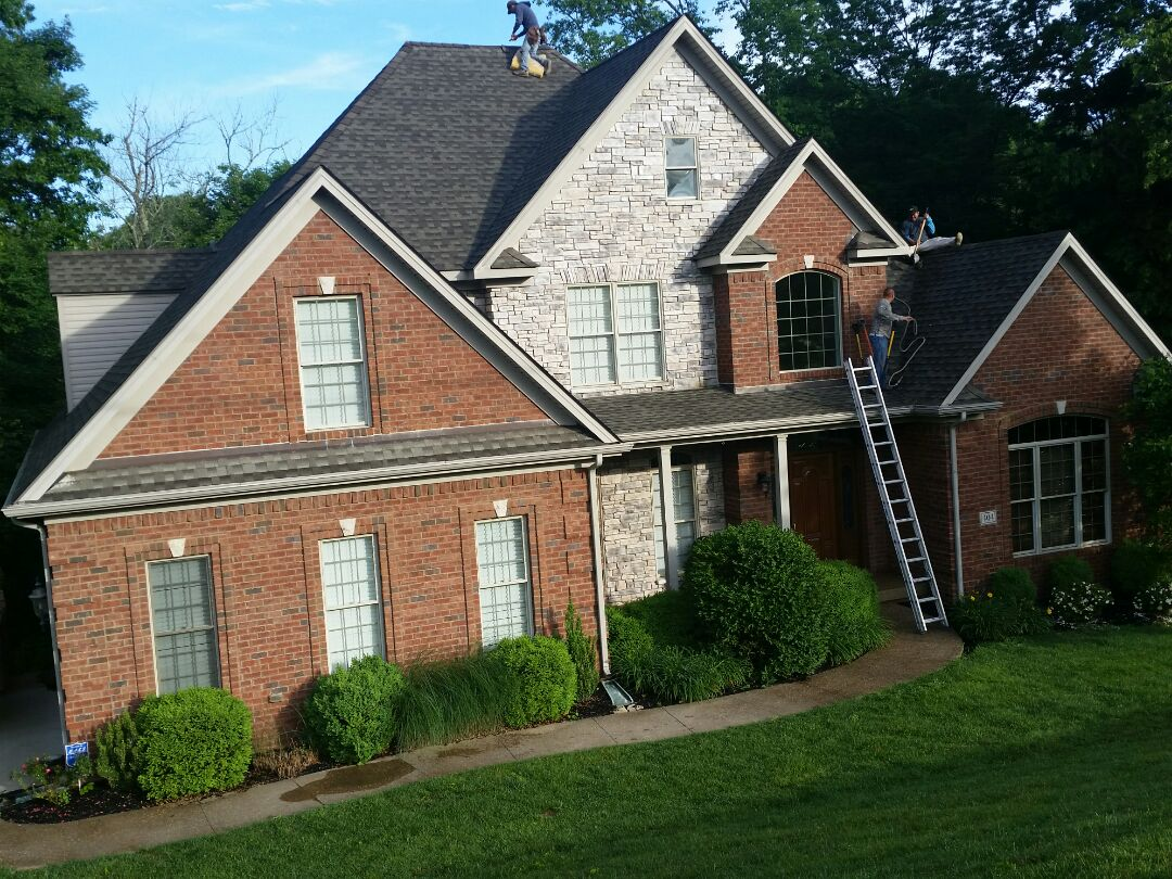 Richmond, KY - Out in Boones Trace installing a Mission Brown GAF Timberline roof with new copper flashing