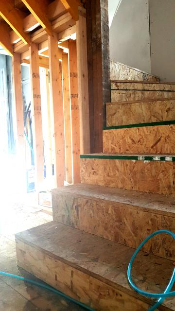 Hamtramck, MI - Attic Conversion - Rough framing of winder stairs providing access to newly conditioned living space.  Increase the square footage of your existing home!