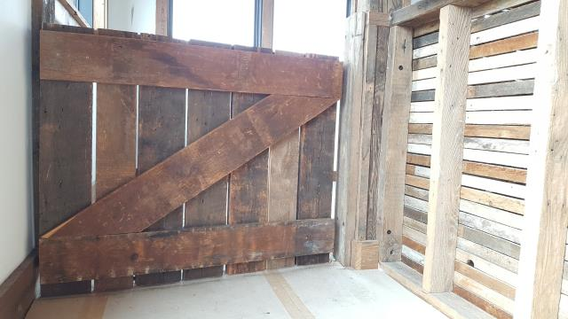 Detroit, MI - Custom reclaimed gate partitions for the El Moore Gardens retail space.  If you're looking for custom millwork & trim, finishes, or carpentry in the Detroit area give us a call.