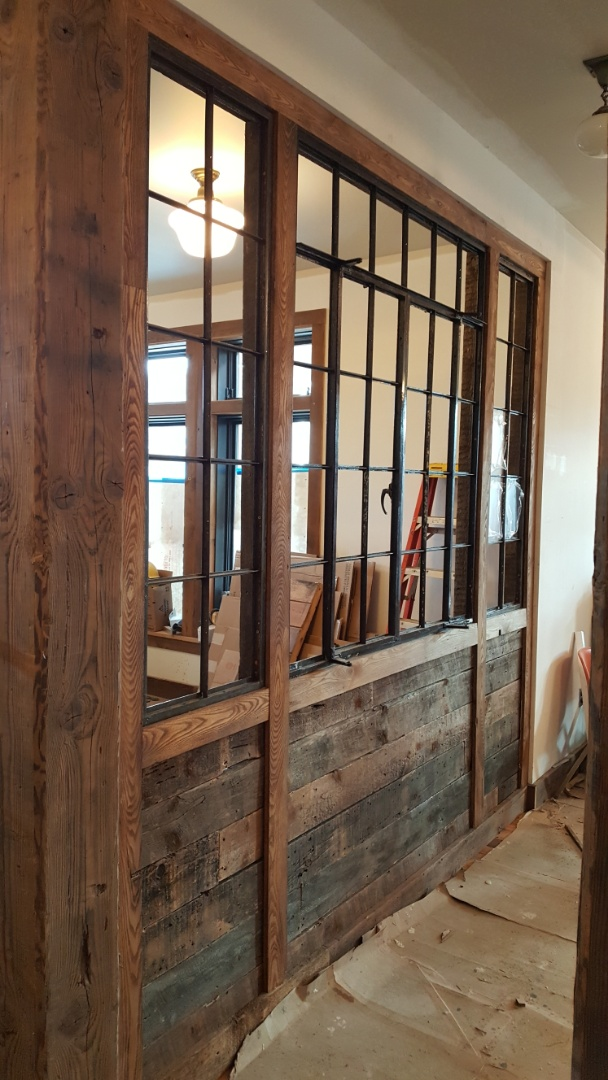 Detroit, MI - Reclaimed wood and remediated casement windows form the dividing wall between the retail space and the maker space at the El Moore Gardens.  The Green Garage in Detroit is using this project to improve the community and bring sustainability to the attention of business.  If you're looking for a custom finish carpentry, millwork & trim contractor give us a call!