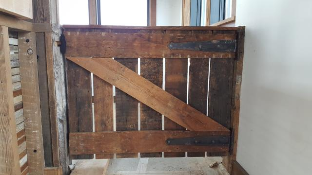Detroit, MI - Reclaimed gates at the El Moore Gardens sustainable retail space in Midtown Detroit.  If you're looking for a custom carpenter, millwork, and trim contractor for your next residential remodeling project or commercial build give us a call!