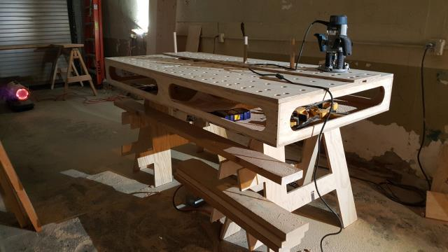 Detroit, MI - The portable job site workbench is almost complete!  Finishing up the bench dog holes with a router template here.  Last step is to fabricate the router fence and give it a final sanding.  Takes just a few minutes to pull out of the trailer and set up, is an out-feed for the table saw, a router table, and large, stable work surface that is lightweight and compact for storage.  This is essentially a replication of the Paulk Compact Workbench (Plans available at www.paulkhomes.com) with a few modifications.  Work smarter, not harder!
