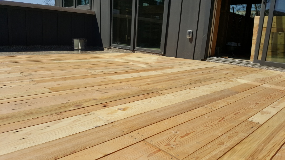Detroit, MI - Reclaimed timber decking,  custom made click together platforms make this deck removable and storeable in winter!