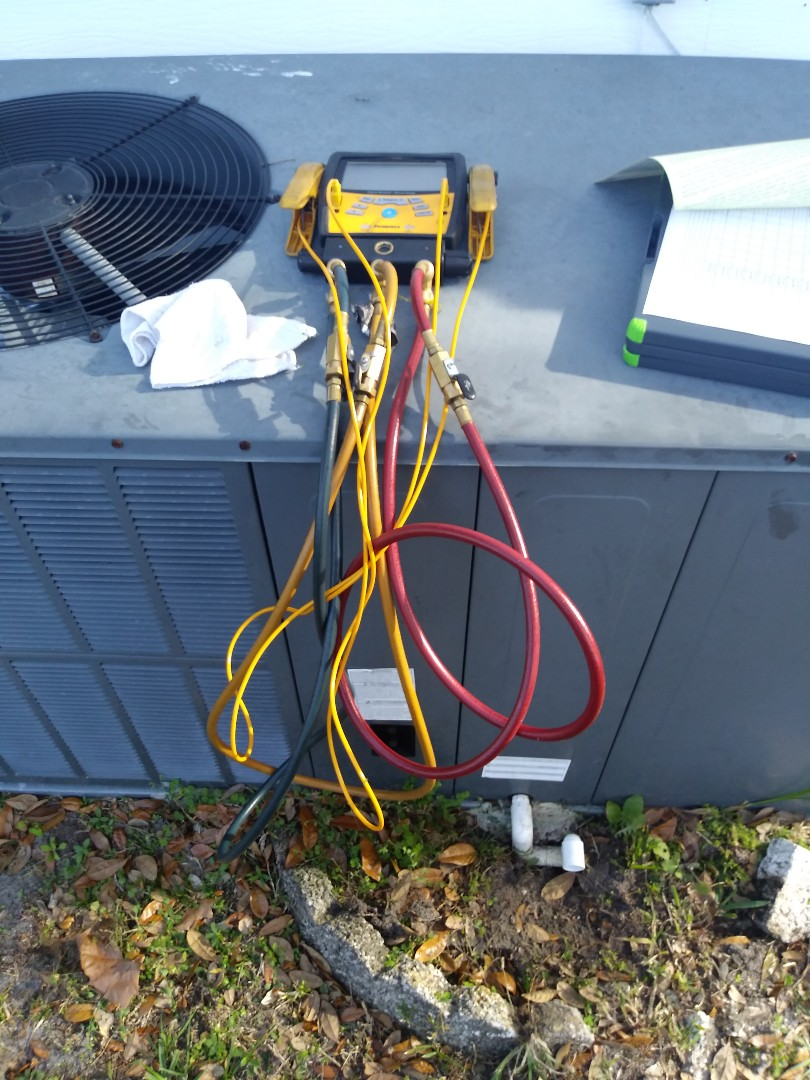 Zellwood, FL - Preventive maintenance on a package unit for air conditioning for family and Zellwood
