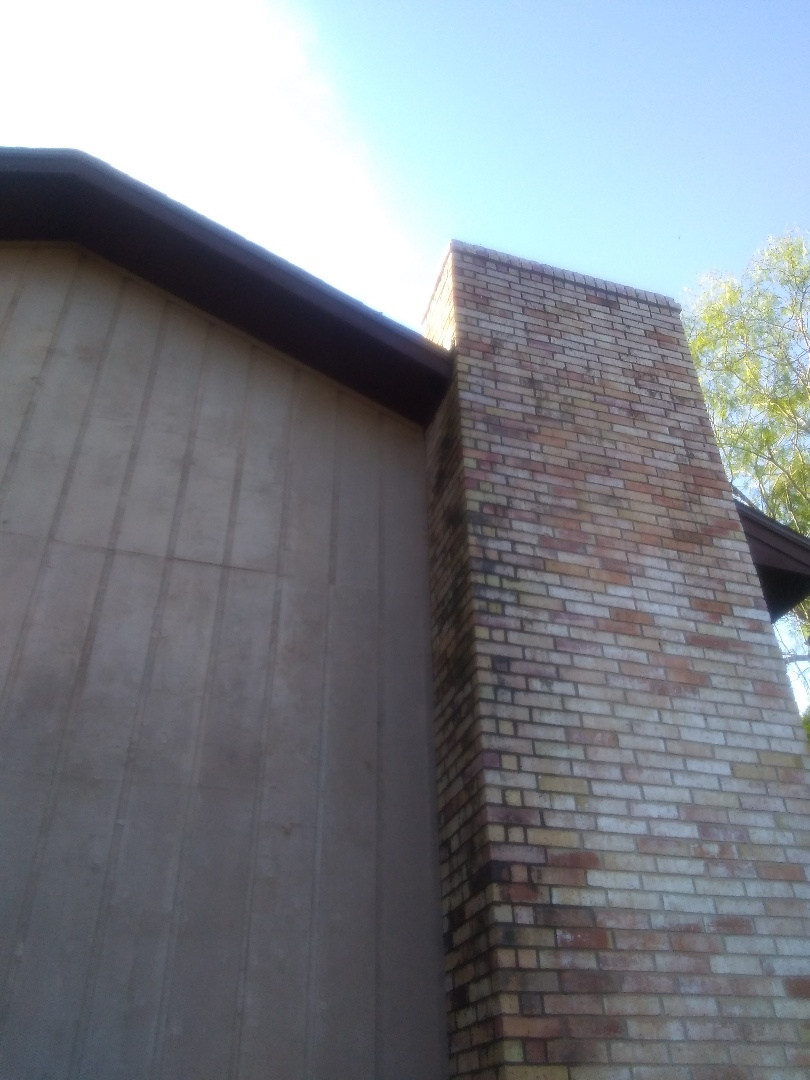 McAllen, TX - Bee Removal from roof eve, near the chimney.  Sprayed will bee and wasp repellent after removing nest.
