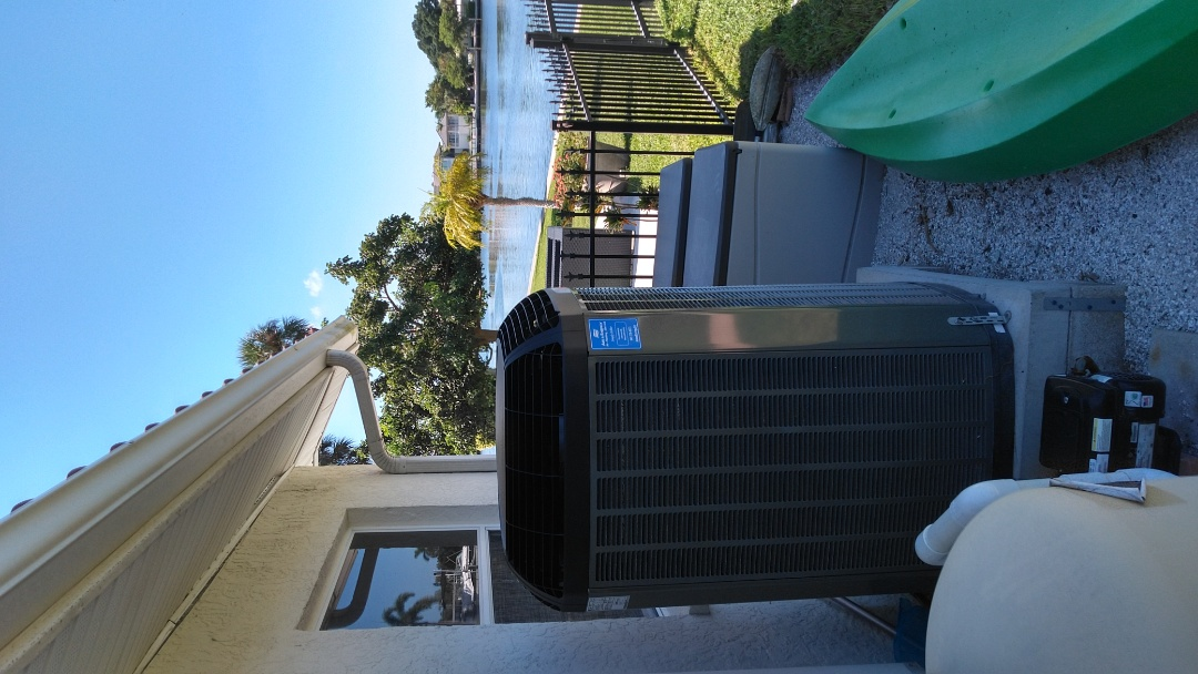 Perform AC maintenance on Trane heatpump system.