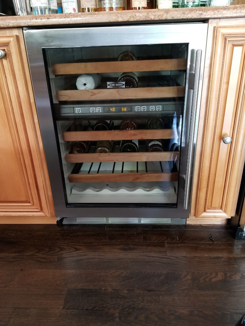 Amagansett, NY - Sub Zero Wine Refrigerator, not cooling. Fan motor needs adjustment and condensor needs cleaning.