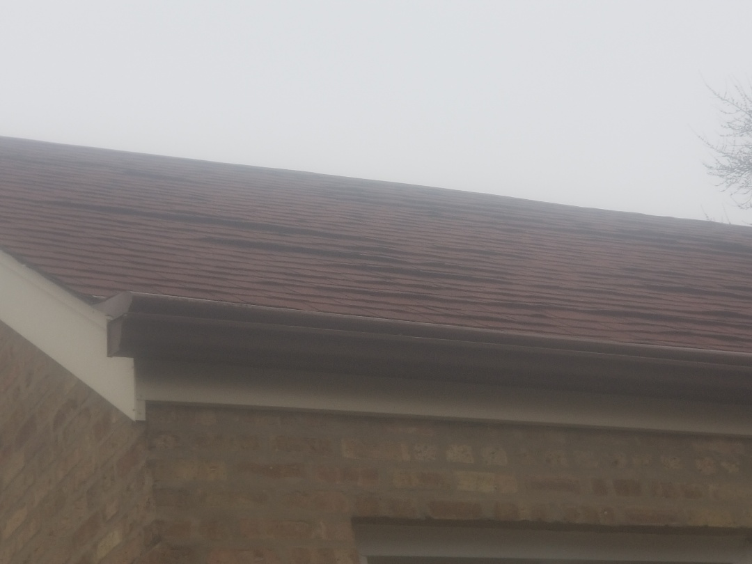 8nspection of roof for manufacturers defective shingles.