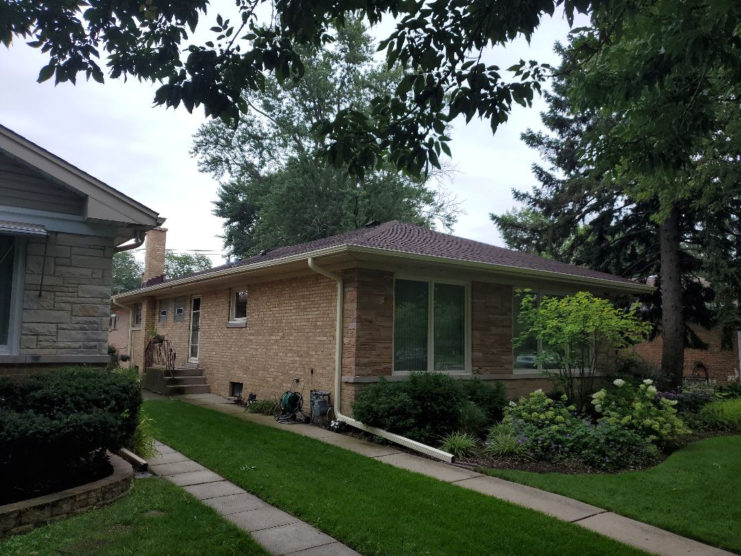 Skokie, IL - Final inspection of GAF Timberline Lifet8me shingles. Final inspection of gutter and down spout install.