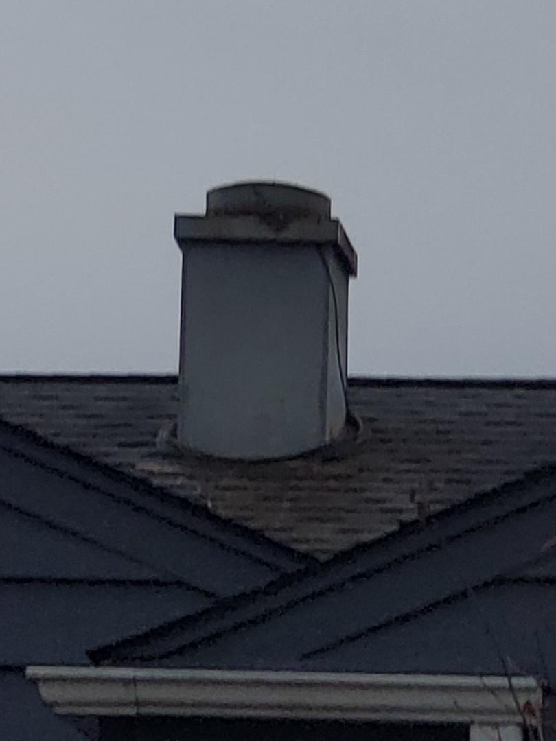 new metal chimney housing